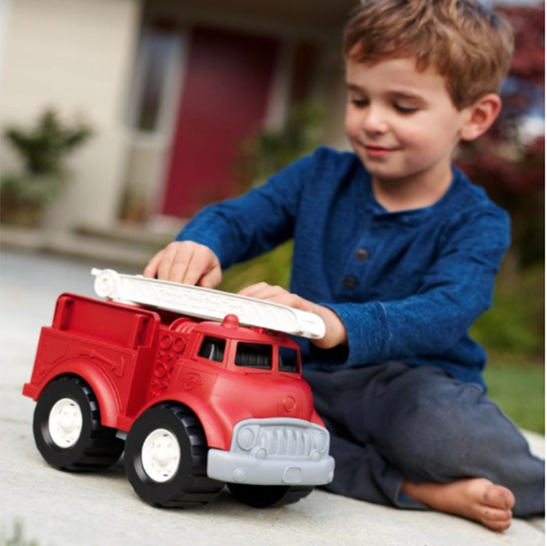 Boy playing with Green Toys fire truck