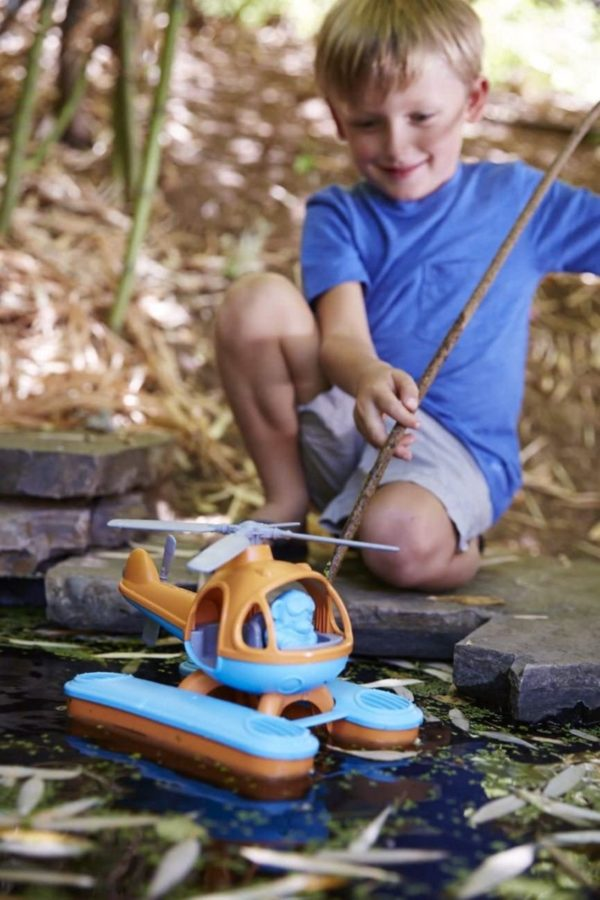 Boy playing with seacopter in creek