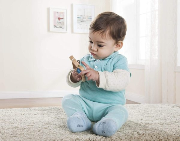 Baby playing with Everearth rattle