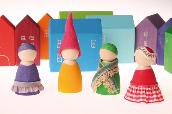 Grimms wooden dolls in play