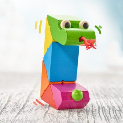 Wooden snake toy in rainbow colours