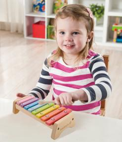 Ever earth wooden xylophone played by child