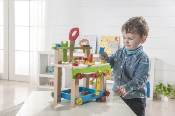 Child playing with pretend tools