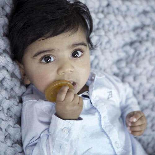 Baby with natural rubber soother
